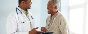 A FAMILY NURSE PRACTITIONER HAS A CONSULTATION WITH HIS PATIENT