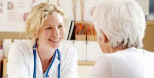 A FAMILY NURSE PRACTITIONER MEETS WITH HER PATIENT