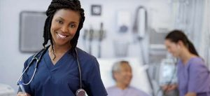 A FAMILY NURSE PRACTITIONER SMILES FOR THE CAMERA