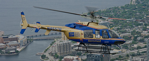 A NURSE AND PILOT FLY OVER THE CITY OF TAMPA