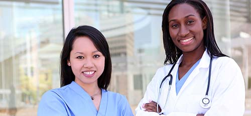 AN ONCOLOGY NURSE AND AN ONCOLOGIST SMILE FOR THE CAMERA