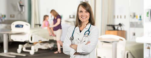 A PEDIATRIC ONCOLOGY NURSE IS SEEN IN THE FOREGROUND